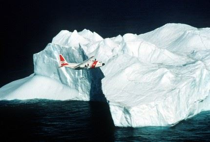 A Coast Guard C-130 fixed wing aircraft overflies an iceberg during patrol.  Service with the International Ice Patrol is one of the many operations of the C-130. (U.S. Coast Guard photo)
